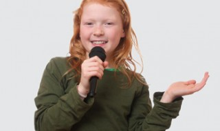 A girl talking into a microphone.