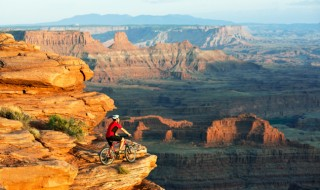 A bicyclist admiring a sweeping view of the Grand Canyon.