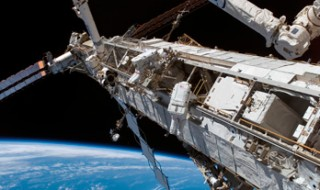 Astronauts working on the International Space Station as it orbits Earth.
