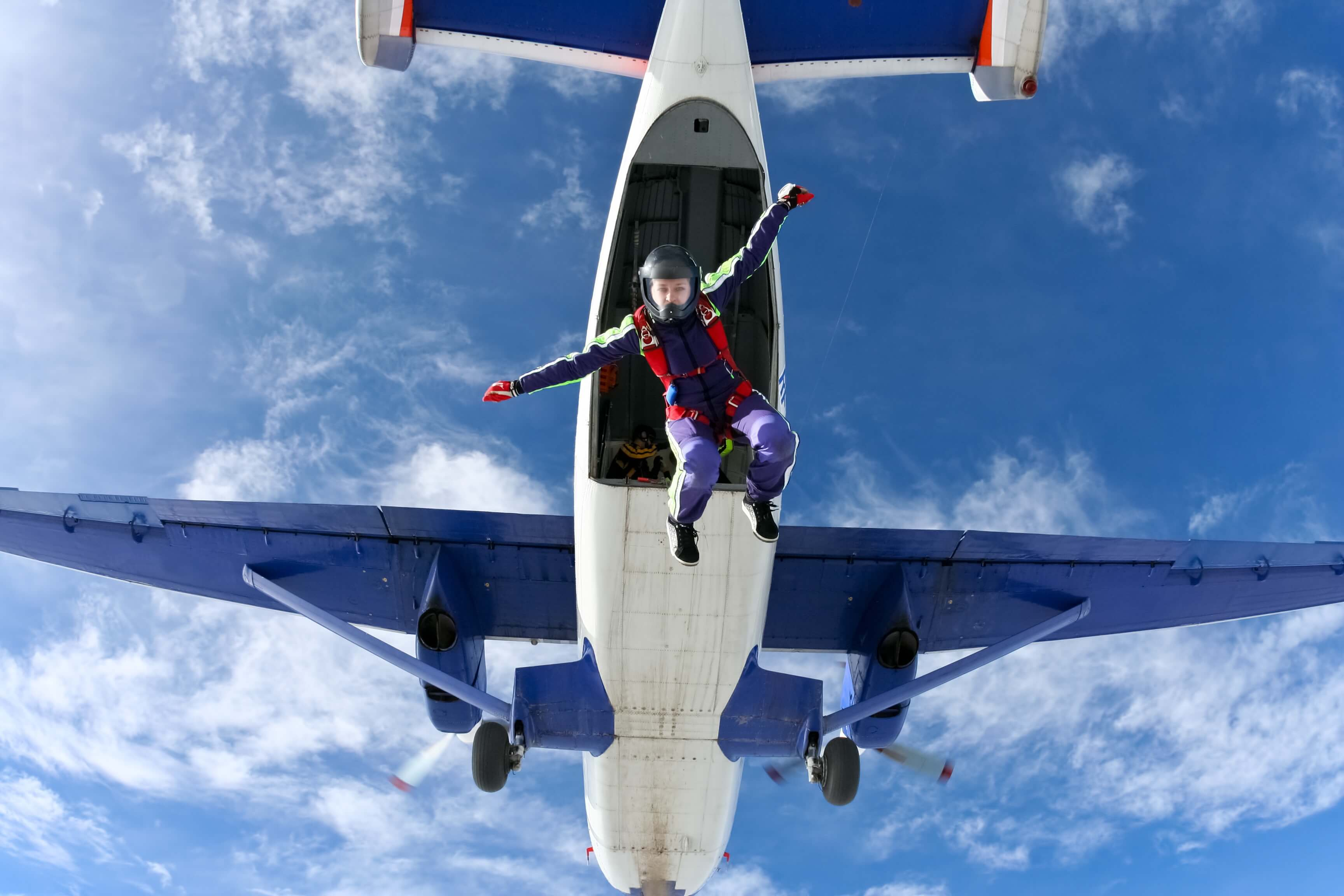 A skydiver jumps from an airplane.