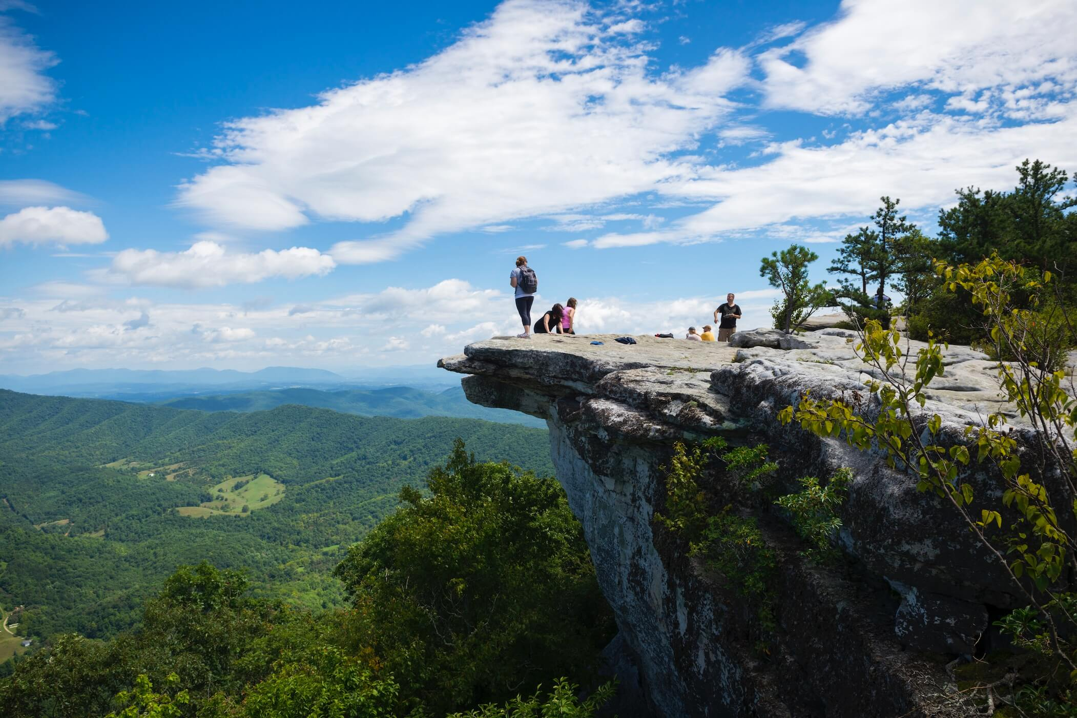 People explore a cliff on the Appalachian Trail.