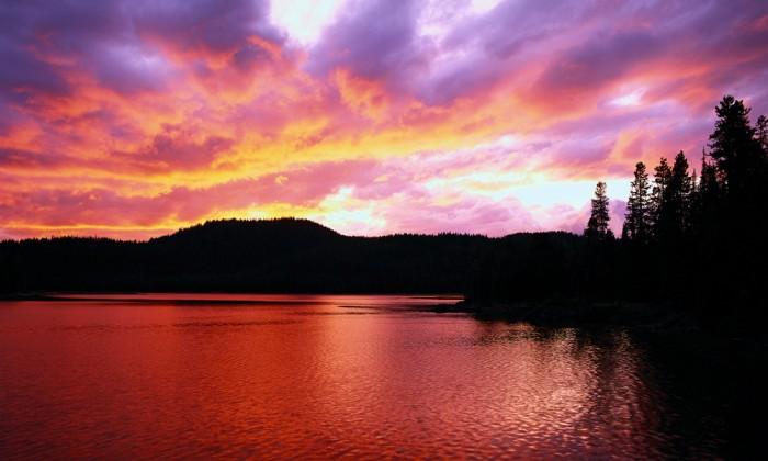 dramatic sunset over a lake