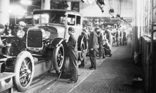 Assembly line workers inside the Ford Motor Company factory at Dearborn, Michigan
