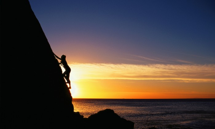 Rock Climber Silhouette at Sunset
