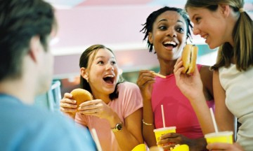 teens eating hamburgers