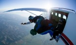 Two skydivers jumping out of airplane, aerial view, Snohomish, Washington, USA