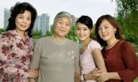 Multi generational female family portrait in Century Park, Shanghai, China