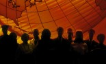 Silhouette of group of people against globe