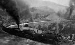 Freight train winding through mountains