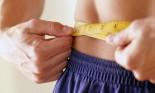 measuring tape around a person's waist