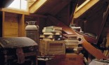 Attic with old books, boxes, chest