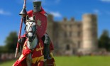 Medieval red jousting knight on horse near castle