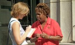 Reporter interviewing a woman on a street of Chicago, Illinois