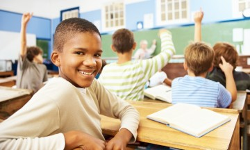 Elementary student smiling in classroom