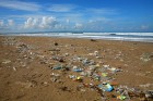 Trash, litter on beach with blue sky
