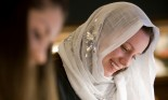 Muslim girl writing