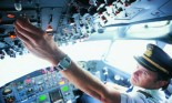 Pilot in cockpit of commercial airplane