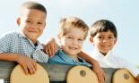 Three boys playing in school yard