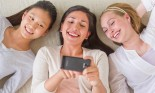 three girls looking at phone