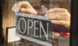 pinning an open sign to door