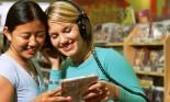 girls looking at CD