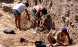 Three researchers hand-picking in a dig within the remains of ancient Greek and Roman settlements, Empuries L'Escala, Costa Brava