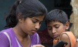 Indian brother and sister (12-13 years old) using tablet device, Agra, Uttar Pradesh, India
