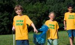 Children (8-10 years old) walking with garbage bags for recycling, Prospect Park, Brooklyn, NY