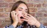 Teenage girl yawning