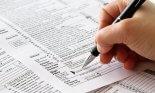 Hand signing tax return form