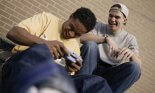 Two teens laughing