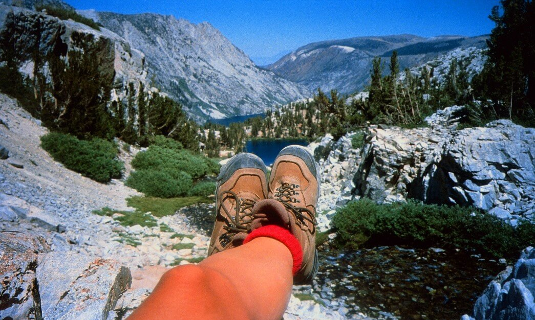 hikers feet and mountain view