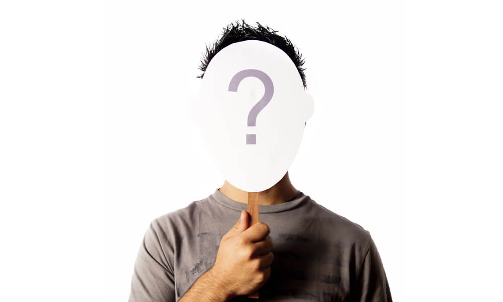 Man with question mark mask over his face