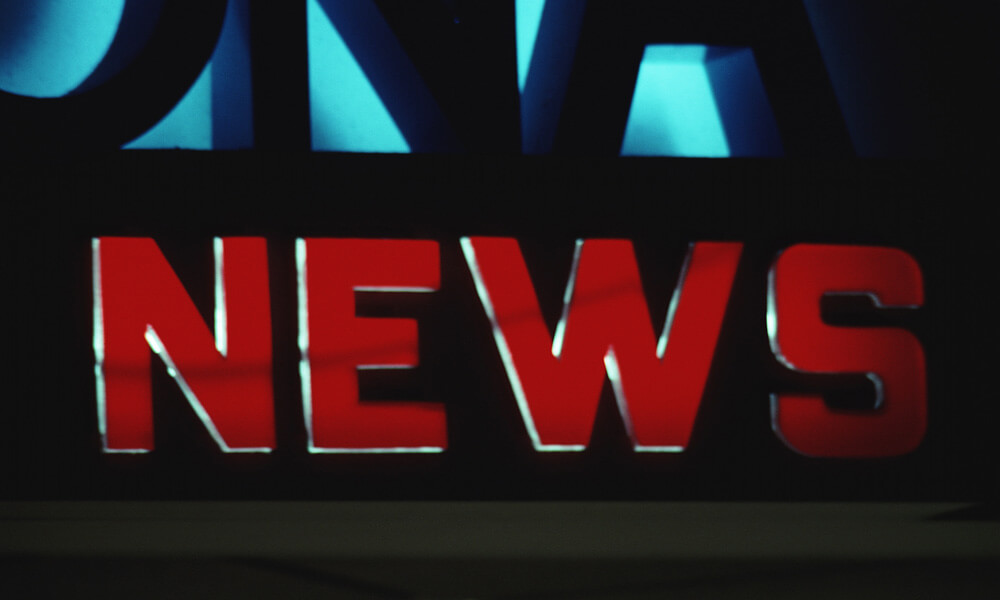 Sign that reads NEWS in red lettering