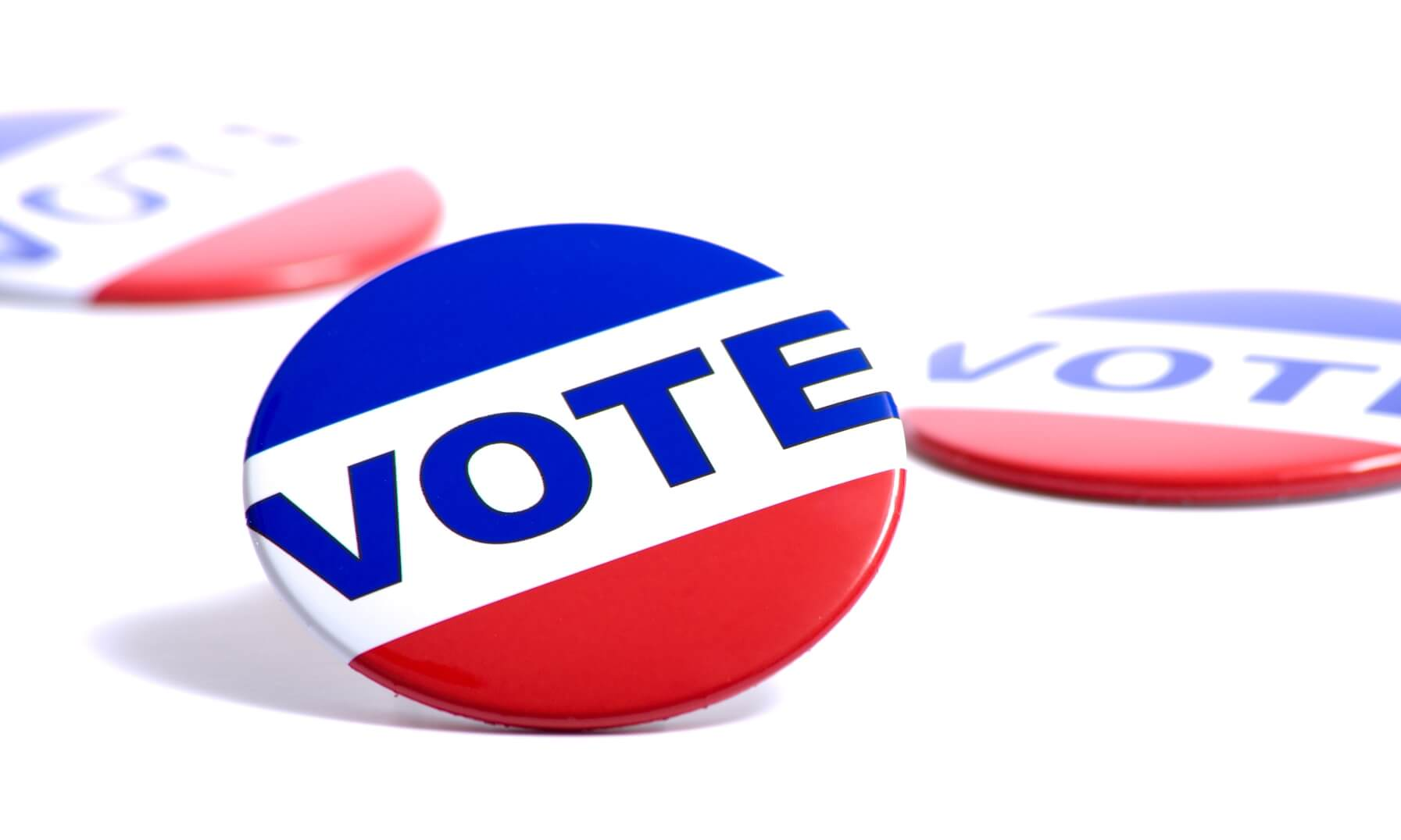 "Political red, white, and blue button with the word ""vote"" on it"