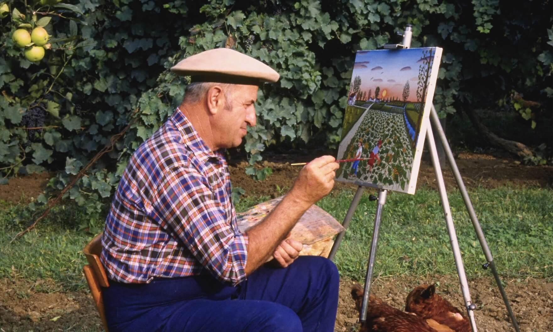 Man Painting in Garden