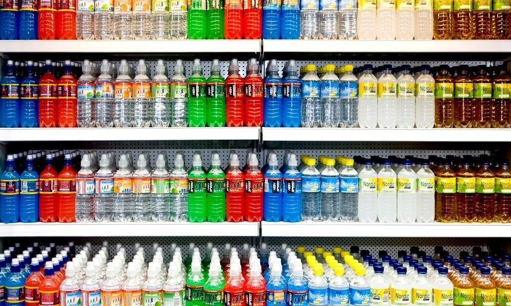 Rows of drinks' bottles on shelves