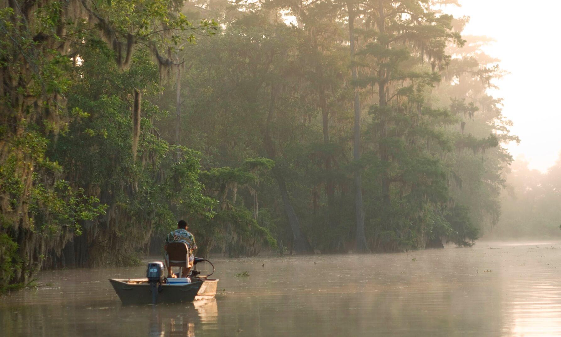 Man in boat on Lake Martin, Lafayette, Louisiana, USA