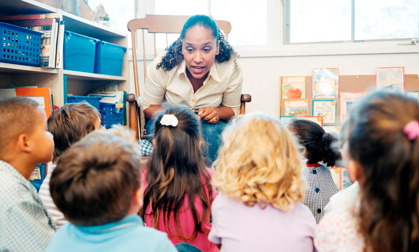 Teacher telling story to schoolchildren