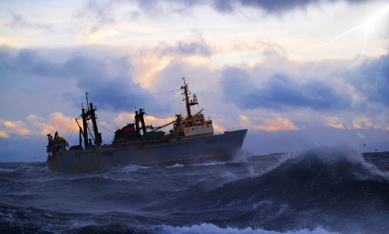 Fishing boat in stormy seas