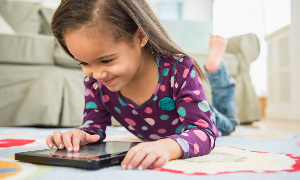 Hispanic girl (4-5 years old) using tablet compute