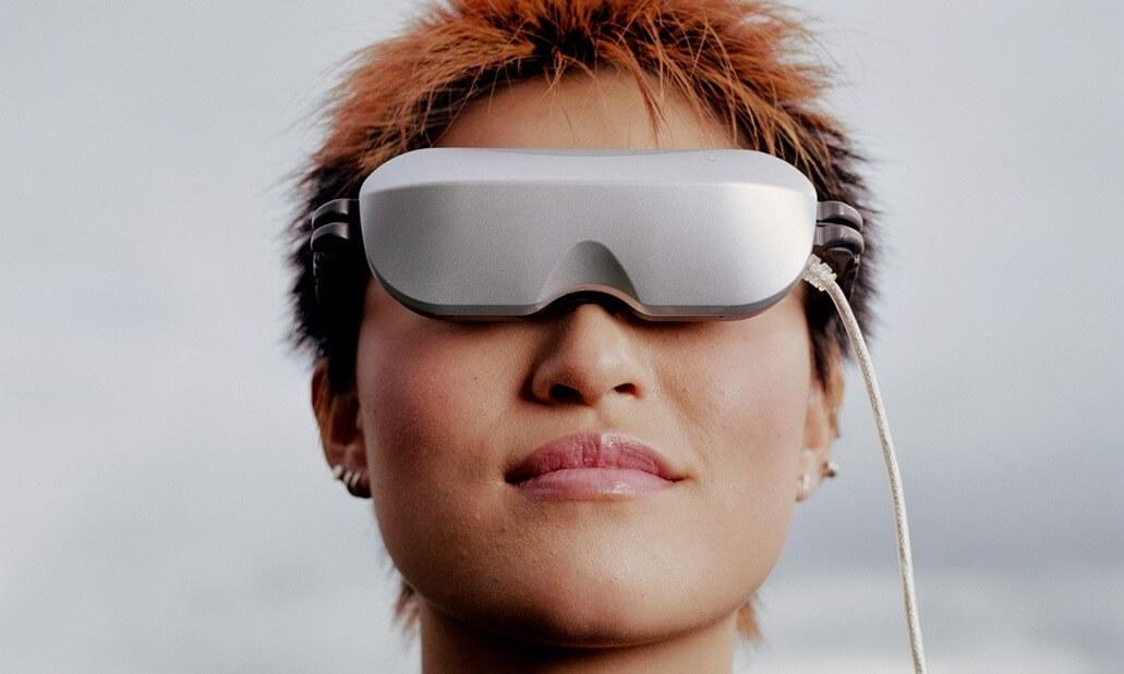 female headshot wearing tech glasses