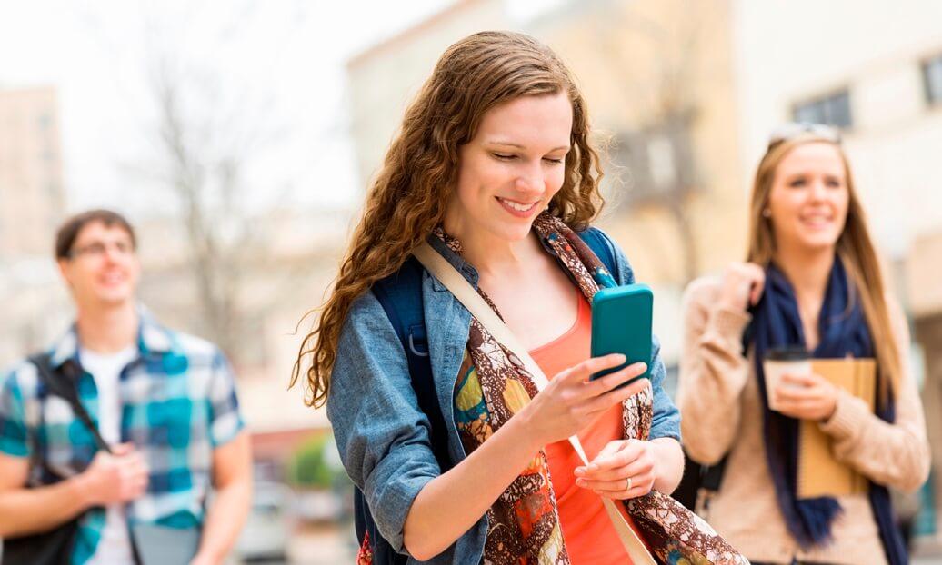 teenage girl looking at phone