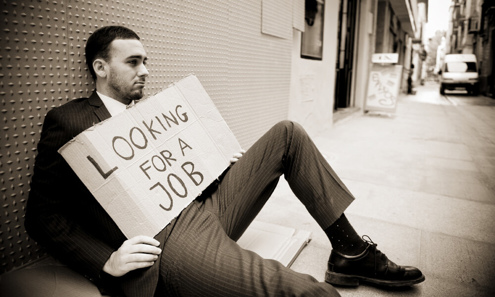Young man holding sign Looking for a job