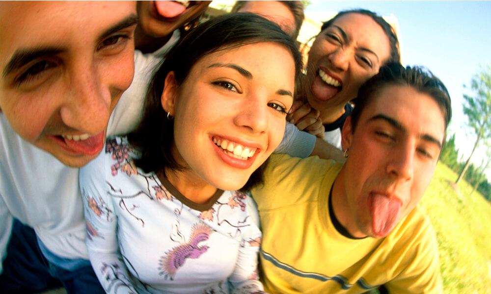 Portrait of a group of teenagers making faces