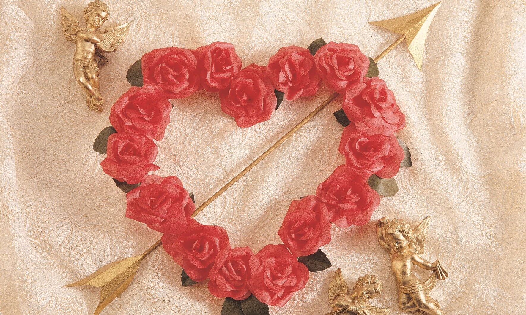 Roses in the shape of a heart pierced by Cupid's arrow