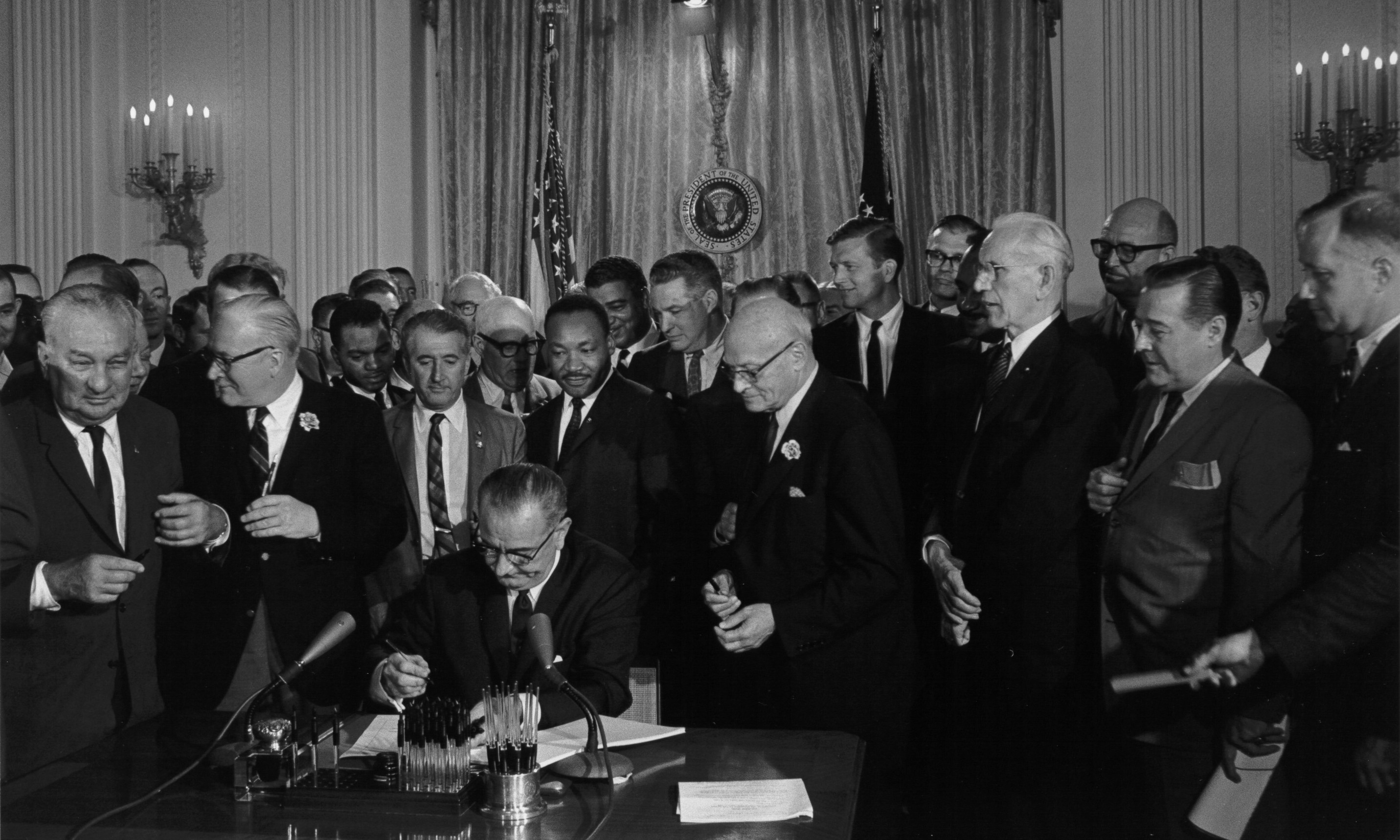 President Lyndon Johnson signing the Civil Rights Act.