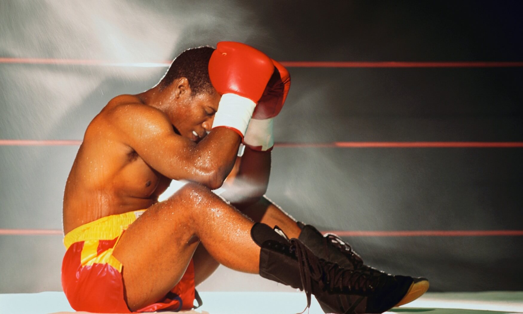 Dejected Boxer Sitting in the Ring