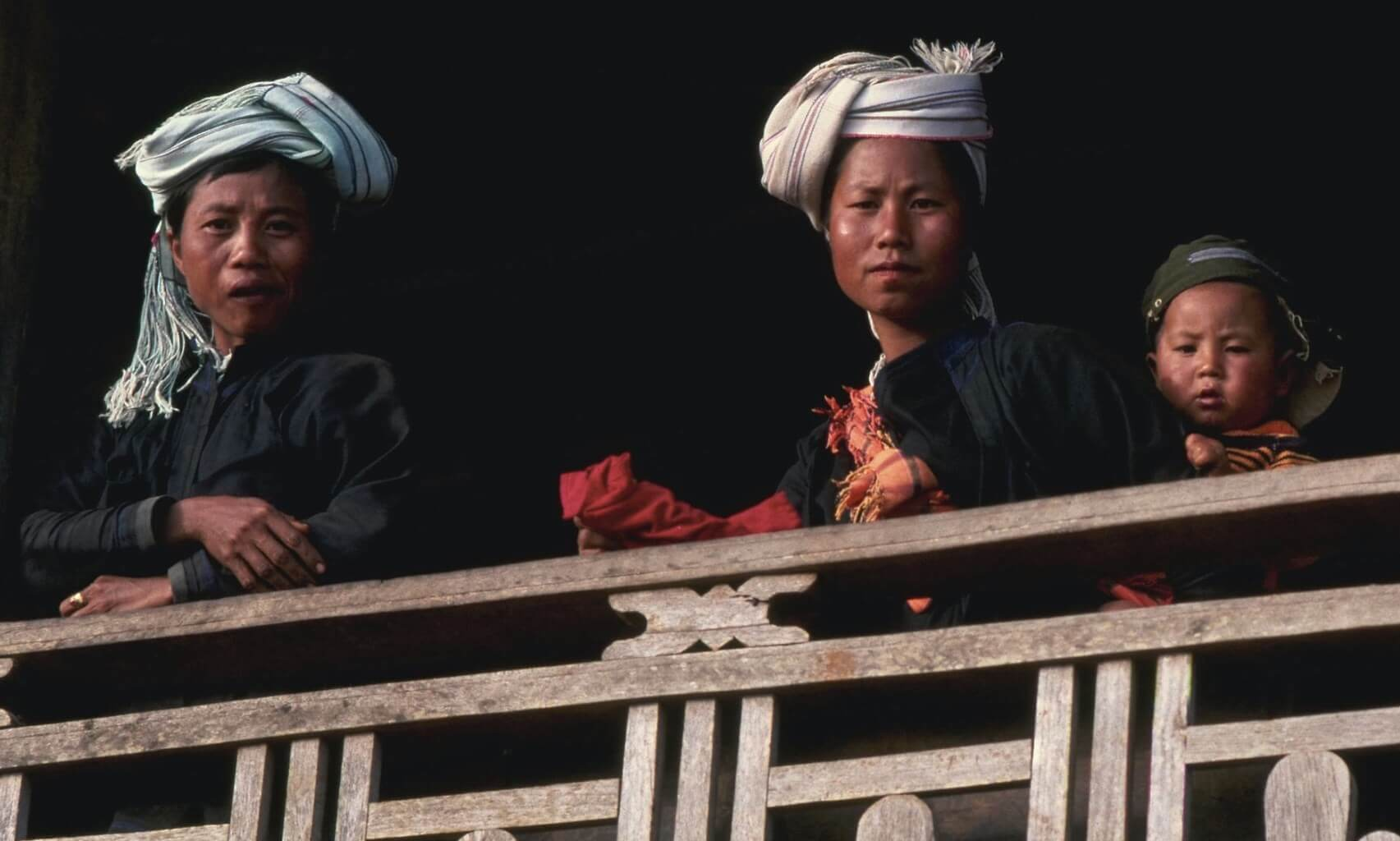 People on House Balcony in Myanmar