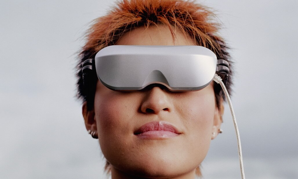 Woman wearing virtual reality glasses.